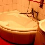 Renovated Bathroom with a corner bathtub